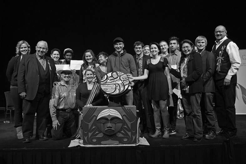 Aboriginal and non-Aboriginal representatives from 4Rs Youth Movement present the 4Rs drum made by Nisga'a artist Mike Dangeli, as an expression of reconciliation at the Truth and Reconciliation Commission Alberta National Event, March 2014.