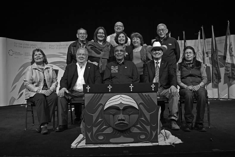 The Indian Residential School Survivor Committee. Left to right, starting in the back: John Morrisseau, Terri Brown, Eugene Arcand, Doris Young, Lottie May Johnson, John Banksland. Seated: Rebekah Uqi Williams, Barney Williams, Gordon Williams, Commissioner Chief Wilton Littlechild, Madeleine Basile.