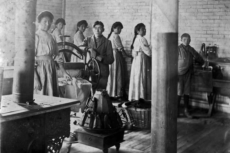 Mount Elgin, Ontario, laundry room. Clothes wringers, such as the one shown here, were a source of injury at a number of residential schools. The United Church of Canada Archives, 90.162P1173.