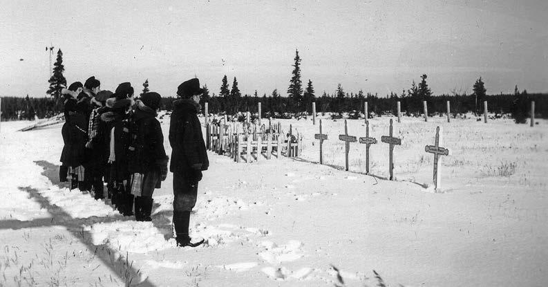 Residential school students at the Roman Catholic cemetery in Fort George, Québec. Deschâtelets Archives.