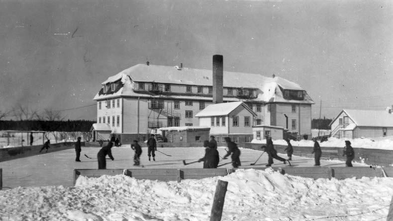 Boys playing hockey at the McIntosh, Ontario, school. Many students said that they would not have survived their residential school years, were it not for sports. St. Boniface Historical Society, Oblates of Mary Immaculate, Manitoba Province Fonds, SHSB 29362.