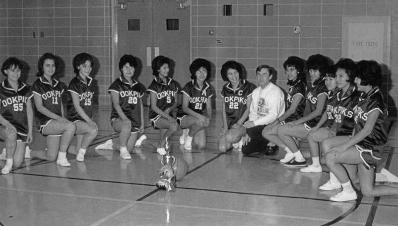 "Grandin College girls' basketball team, Northwest Territories. One Grandin student wrote in the school newsletter, ""At Grandin, Education comes first."" Although students could participate in school sports teams, ""if you are behind in your school work, you are forced to quit your sports."" Deschâtelets Archives."