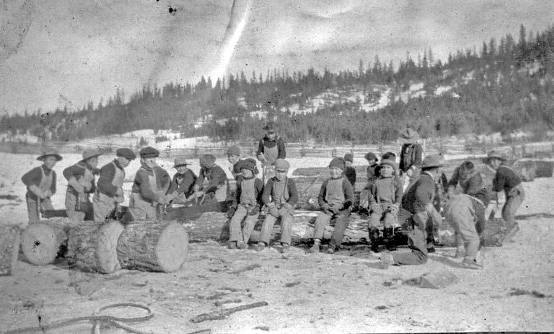 Boys cutting wood at the Williams Lake, British Columbia, school in either the late nineteenth or early twentieth century. In February 1902 Duncan Sticks froze to death after running away from the school. Museum of the Cariboo Chilcotin.