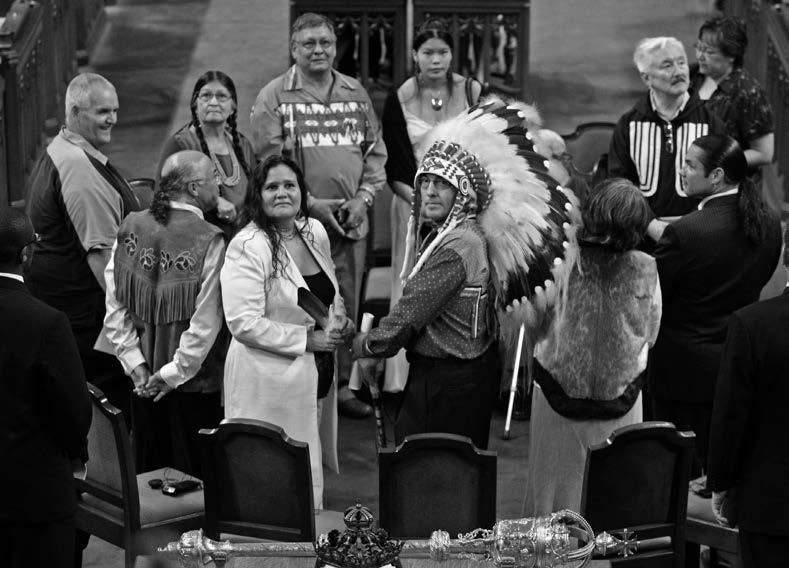 Canada's Aboriginal leaders along with a number of former residential schools students were present on the floor of the House of Commons when Prime Minister Stephen Harper delivered his 2008 apology. Clockwise from the left: former student Don Favel; former student Mary Moonias; former student Mike Cachagee, President of the National Residential School Survivors Society; former student Crystal Merasty; former student Piita Irniq; Patrick Brazeau, National Chief of the Congress of Aboriginal Peoples; Mary Simon, President of the Inuit Tapiriit Kanatami; Phil Fontaine, National Chief of the Assembly of First Nations; Beverley Jacobs, President of the Native Women's Association of Canada; Clem Chartier, President of the Métis National Council. Former student Marguerite Wabano is obscured by Phil Fontaine's headdress. Canadian Press: Fred Chartrand.